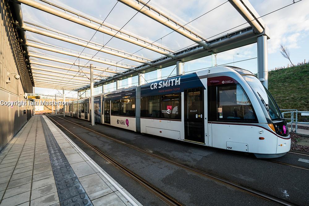 View of tram at platforms at modern Edinburgh Gateway railway and tram station that connects Scotrail train passengers with the Edinburgh Tram link  in Edinburgh, Scotland, United Kingdom.