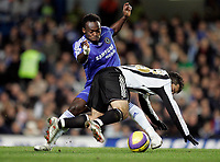 Photo: Marc Atkins.<br /> Chelsea v Newcastle United. The Barclays Premiership. 13/12/2006. Giuseppe Rossi of Newcastle is tripped by Michael Essien of Chelsea.