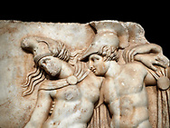 Close up of a Roman Sebasteion relief sculpture of Achilles and a dying Amazon, Aphrodisias Museum, Aphrodisias, Turkey.     Against a black background.<br /> <br /> Achilles supports the dying Amazon queen Penthesilea whom he has mortally wounded. Her double headed axe slips from her hands. The queen had come to fight against the Greeks in the Trojan war and Achilles fell in love with her. .<br /> <br /> If you prefer to buy from our ALAMY STOCK LIBRARY page at https://www.alamy.com/portfolio/paul-williams-funkystock/greco-roman-sculptures.html . Type -    Aphrodisias     - into LOWER SEARCH WITHIN GALLERY box - Refine search by adding a subject, place, background colour, museum etc.<br /> <br /> Visit our ROMAN WORLD PHOTO COLLECTIONS for more photos to download or buy as wall art prints https://funkystock.photoshelter.com/gallery-collection/The-Romans-Art-Artefacts-Antiquities-Historic-Sites-Pictures-Images/C0000r2uLJJo9_s0