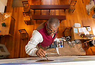 Leo Rucker, Lead Interpreter at St. Philips African American Site in Old Salem, paints a mural titled Witnesses in the Clouds, June 20, 2018 in Winston-Salem, N.C.<br /> Photo by Mark DiOrio