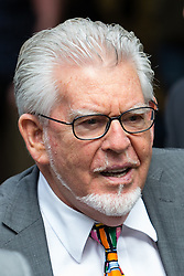 © Licensed to London News Pictures. 04/07/2014. London, UK. Artist and television personality, Rolf Harris arrives at Southwark Crown Court in London on 4th July 2014 for sentencing. Rolf Harris has been found guilty on 12 counts of indecent assault. Photo credit : Vickie Flores/LNP