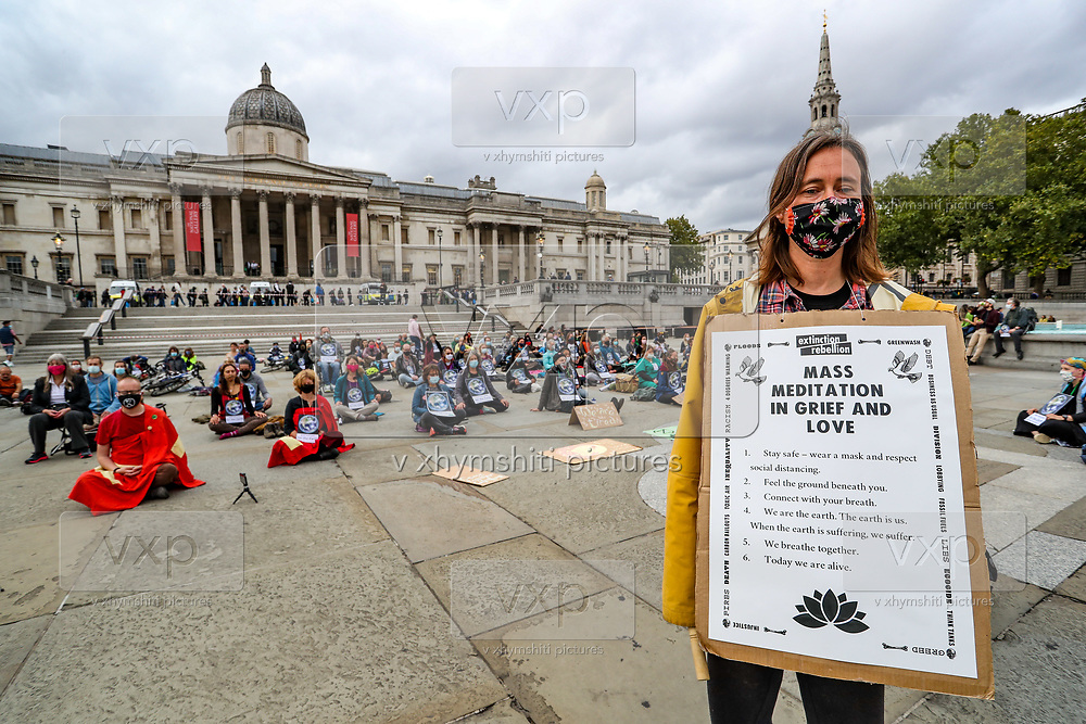 Members of Extinction Rebellion activists group gathered in a mass meditation in Trafalgar Square, central London on Friday, Sept 4, 2020. There are other Extinction Rebellion protests ongoing in London. Environmental nonviolent activists group Extinction Rebellion enters its 4th day of continuous ten days protests to disrupt political institutions throughout peaceful actions swarming central London into a standoff, demanding that central government obeys and delivers Climate Emergency bill. (VXP Photo/ Vudi Xhymshiti)