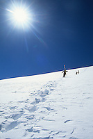 A group of skiers hike up a bootpack trail in the Jackson Hole Mountain Resort backcountry, Jackson Hole, Wyoming.