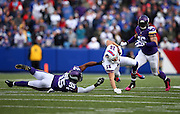 Minnesota Vikings outside linebacker Anthony Barr (55) upends Buffalo Bills wide receiver Chris Hogan (15) during the NFL week 7 regular season football game against the Buffalo Bills on Sunday, Oct. 19, 2014 in Orchard Park, N.Y. The Bills won the game 17-16. ©Paul Anthony Spinelli