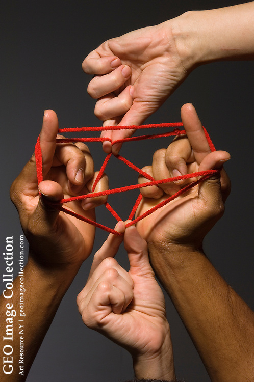 Studio shot of human hands playing a string game.