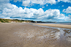 Damp sand hold the patterns on the waves after the receeding tide, looking away from Bridlington town along North Beach West Yorkshire England<br /> <br />  4 August 2016<br />  Copyright Paul David Drabble<br />  www.pauldaviddrabble.photoshelter.com