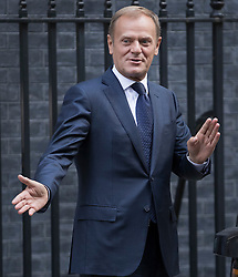 © Licensed to London News Pictures. 08/09/2016. London, UK. President of the European Council, Donald Tusk gestures to reporters as he leaves Downing Street after meeting with Prime Minister Theresa May.  Photo credit: Peter Macdiarmid/LNP