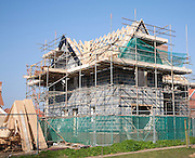 House under construction on new housing development by Hopkins and Moore at Snape, Suffolk, England