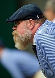 LONDON, ENGLAND - Saturday, July 6, 2019: A bearded line judge during the Gentlemen's Singles third round match on Day Six of The Championships Wimbledon 2019 at the All England Lawn Tennis and Croquet Club. (Pic by Kirsten Holst/Propaganda)