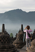 Tourist taking photograph, Borobudur, Borobudur, Kedu Valley, South Central Java, Java, Indonesia, Southeast Asia