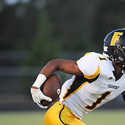 Fairmont's Shyheim Hines rushes against Ashley High School Friday September 5, 2014 in Wilmington, N.C. (Jason A. Frizzelle)