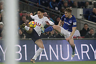 Jonjoe Kenny of Everton goes in with his studs high on Heung Min Son Tottenham Hotspur (l).<br /> Premier league match, Tottenham Hotspur v Everton at Wembley Stadium in London on Saturday 13th January 2018.<br /> pic by Kieran Clarke, Andrew Orchard sports photography.