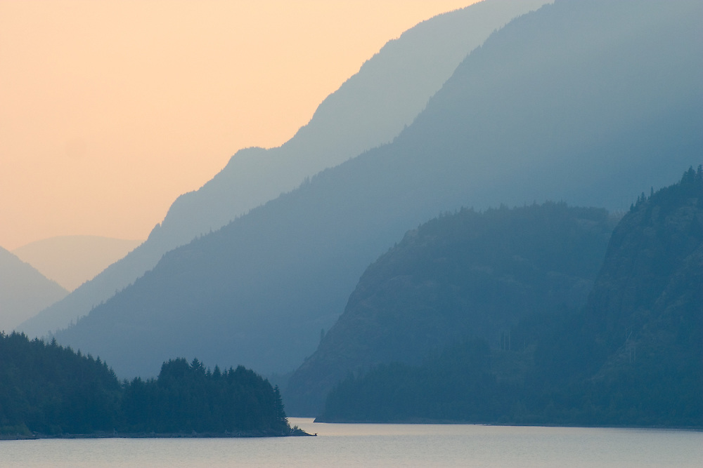 Smoke from forest fires colours sky above Upper Campbell Lake, Vancouver Island BC