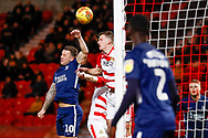 Southend United forward Simon Cox (10) battles in the air  during the EFL Sky Bet League 1 match between Doncaster Rovers and Southend United at the Keepmoat Stadium, Doncaster, England on 12 February 2019.