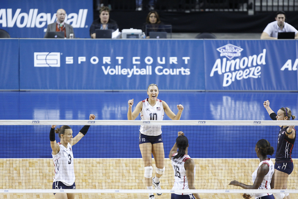 Jordan Larson #10 and teammates celebrate after a point during USA Volleyball's 3-0 win over Canada at Pinnacle Bank Arena in Lincoln, Neb., on Jan. 7, 2016. Photo by Aaron Babcock, Hail Varsity