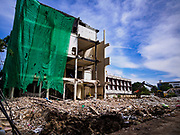 12 NOVEMBER 2017 - BANGKOK, THAILAND:  A row of shophouses being demolished on Sukhumvit Soi 63 (Ekkamai) in Bangkok. The shophouses and the buildings that used to be on the lots behind the shophouses were bought by a developer who is building an office tower on the site.     PHOTO BY JACK KURTZ
