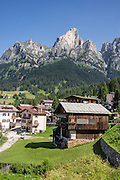 Monte Cernera (2657 meters) rises above Santa Fosca/Pescul village, along Strada Statale 251 in the Dolomites, Veneto region, Italy, Europe. The Dolomites are part of the Southern Limestone Alps, in northern Italy, Europe. UNESCO honored the Dolomites as a natural World Heritage Site in 2009.