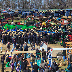 Gordonville, PA, USA - March 10, 2012: Amish and non-Amish watch items being sold at a public mud sale to benefit the Gordonville Volunteer Fire Company in Lancaster County, PA.