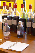 Domaine Jean Louis Denois. Limoux. Languedoc. Samples for control and reference. A notebook on the table. Tasting wine. France. Europe. Bottle.