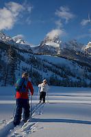 Russell Laman (age 12) and Jessica Laman (age 9)  cross-country skiing below the Teton Range, right toward the Grand Teton.<br />Grand Teton National Park, Wyoming