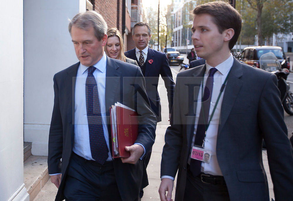 © Licensed to London News Pictures. 07/11/2012. London, UK. Owen Paterson (L), the Secretary of State for Environment is seen arriving at a tree health summit to discuss the ash dieback disease outbreak in London today (07/11/12). The meeting, chaired by Mr Paterson, will bring together scientists non-governmental agencies and stakeholders to discuss tree health and ways to tackling the present British outbreak of ash dieback disease. Photo credit: Matt Cetti-Roberts/LNP