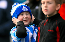 A young Huddersfield Town fan ahead of the Premier League match at the John Smith's Stadium, Huddersfield.