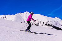 Skiers on Sneaky's (ski run), Aspen/Snowmass ski resort, Snowmass Village, Colorado USA.