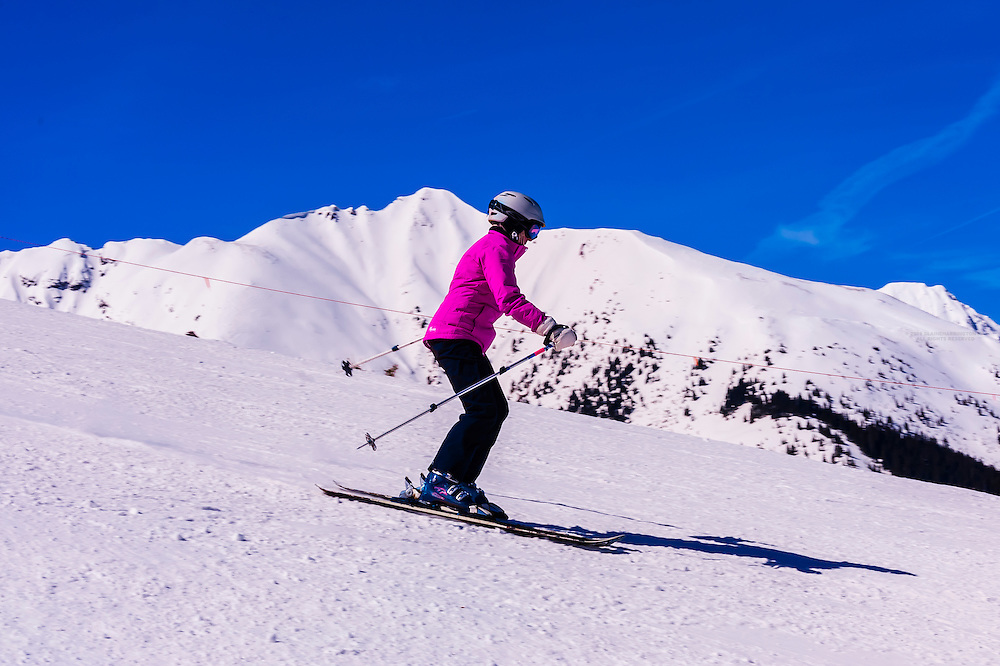 Skiers on Sneaky's (ski run), Aspen/Snowmass ski resort, Snowmass Village, Colorado USA.