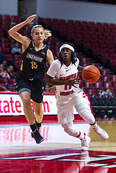 NORMAL, IL - October 30: Tete Maggett steps past Devin Fuhring heading for the hoop during a college women's basketball game between the ISU Redbirds and the Lions on October 30 2019 at Redbird Arena in Normal, IL. (Photo by Alan Look)