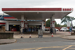 © Licensed to London News Pictures. 27/09/2021. London, UK. A closed Esso petrol station near Hanger Lane, West London. The petrol station is closed due to problems with the supply and distribution chain. This has also prompted panic buying by motorists in the last few days. Companies including BP and Shell have restricted deliveries due to the lack of HGV drivers. Photo credit: Ray Tang/LNP