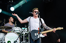 © Licensed to London News Pictures. 03/08/2012. London, UK.  McFly perform live at BT London Live, Hyde Park.  McFly are an English pop-rock band who first found fame in 2004. The band consists of Tom Fletcher (lead vocals, guitar and piano), Danny Jones (lead vocals and guitar), Dougie Poynter (backing vocals and bass guitar) and Harry Judd (drums). In this pic L to R - Harry Judd, Danny Jones.  Photo credit : Richard Isaac/LNP
