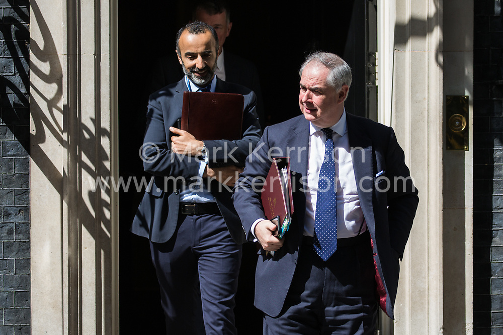 London, UK. 21 May, 2019. Geoffrey Cox QC MP, Attorney General, leaves 10 Downing Street following a mid-afternoon meeting. He left at around the same time as Foreign Secretary Jeremy Hunt, Home Secretary Sajid Javid, International Trade Secretary Liam Fox, Defence Secretary Penny Mordaunt, International Development Secretary Rory Stewart, and Chief Whip Julian Smith and just before Prime Minister Theresa May left to make a statement on her Brexit Withdrawal Agreement Bill following Cabinet approval earlier in the day.