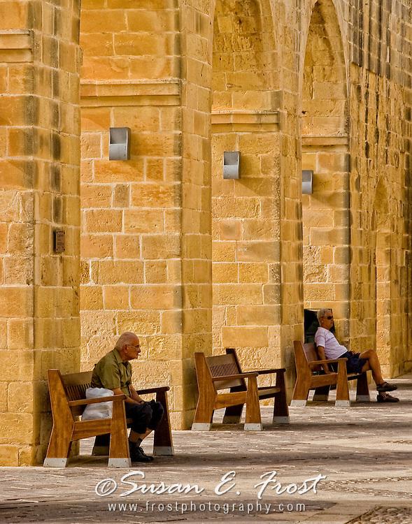Men on bench in Malta