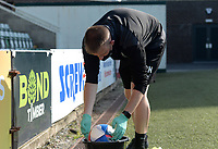 A Plymouth Argyle ground staff member disinfects a match ball during the game<br /> <br /> Photographer Ian Cook/CameraSport<br /> <br /> The EFL Sky Bet League One - Plymouth Argyle v Blackpool - Saturday September 12th 2020 - Home Park - Plymouth<br /> <br /> World Copyright © 2020 CameraSport. All rights reserved. 43 Linden Ave. Countesthorpe. Leicester. England. LE8 5PG - Tel: +44 (0) 116 277 4147 - admin@camerasport.com - www.camerasport.com