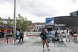 """London, UK. 5th August, 2021. Stop HS2 campaigners take part in outreach activities directly in front of a HS2 Routewide Roadshow at Kings Cross Square. There have been increasing doubts regarding the viability of the northern section of the HS2 high-speed rail link since a recent report published by the Infrastructure and Projects Authority gave Phase 2b the lowest 'red' rating, indicating that successful delivery of the scheme """"appears to be unachievable""""."""