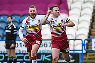 Liam Marshall (2) of Wigan Warriors celebrates his try and makes the score 16-10 to Wigan Warriors during the Betfred Super League match between Huddersfield Giants and Wigan Warriors at the John Smiths Stadium, Huddersfield, England on 1 March 2020.
