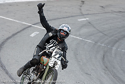 Josh Owens takes a victory lap on a Billy Lane Harley-Davidson board track style motorcycle racer after winning his Sons of Speed Vintage Motorcycle Race at New Smyrina Speedway. New Smyrna Beach, USA. Saturday, March 9, 2019. Photography ©2019 Michael Lichter.