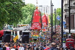 "© Licensed to London News Pictures. 16/06/2019. LONDON, UK.  Devotees celebrate the annual Rathayatra festival (""cart festival""), in central London.  Hare Krishna followers tow three huge decorated carts from Hyde Park corner to Trafalgar Square, singing and dancing all the way..  Photo credit: Stephen Chung/LNP"