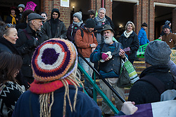 Uxbridge, UK. 1 February, 2020. A man sings the 'HS2 Blues' to environmental activists from Stop HS2, Save the Colne Valley and Extinction Rebellion campaigning against the controversial HS2 high-speed rail link outside the London Borough of Hillingdon Civic Centre in Uxbridge during a 'Still Standing for the Trees' march from the Harvil Road wildlife protection camp in Harefield through Denham Country Park to three addresses closely linked to Boris Johnson in his Uxbridge constituency. The Prime Minister is expected to make a decision imminently as to whether to proceed with the high-speed rail line.