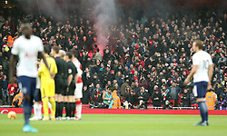 Arsenal fans let off flares during the Premier League match at the Emirates Stadium, London.