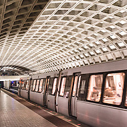 A train leaves the platform at one of the distinctive domed stations of the Washington Metropolitan Area Transit Authority subway system in the Washington DC area. This station is in Ballston, Arlington, a few stops out from downtown Washington DC.
