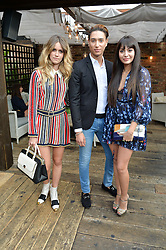 Left to right, WHINNIE WILLIAMS, NAT WELLER and ZARA MARTIN at the Warner Music Group Summer Party in association with British GQ held at Shoreditch House, Ebor Street, London E2 on 8th July 2015.