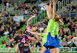 Lara Ortega Gonzales of Metz vs Andrea Penezic of Krim during handball match between RK Krim Mercator (SLO) and  Metz Handball (FRA) in 4th Round of Women's Champions League on November 2, 2013 in Arena Stozice, Ljubljana, Slovenia. (Photo by Vid Ponikvar / Sportida)