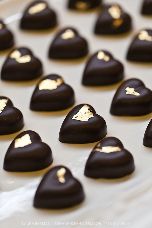 Heart shaped chocolate bonbons with a gold center.