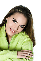 studio shot portrait of a beautiful brunette green eyes young woman on white background