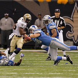 2009 September 13: New Orleans Saints running back Reggie Bush (25) fumbles as Detroit Lions defenders Don Muhlbach (48) and Kalvin Pearson (24) close in on the play during a 45-27 win by the New Orleans Saints over the Detroit Lions at the Louisiana Superdome in New Orleans, Louisiana.
