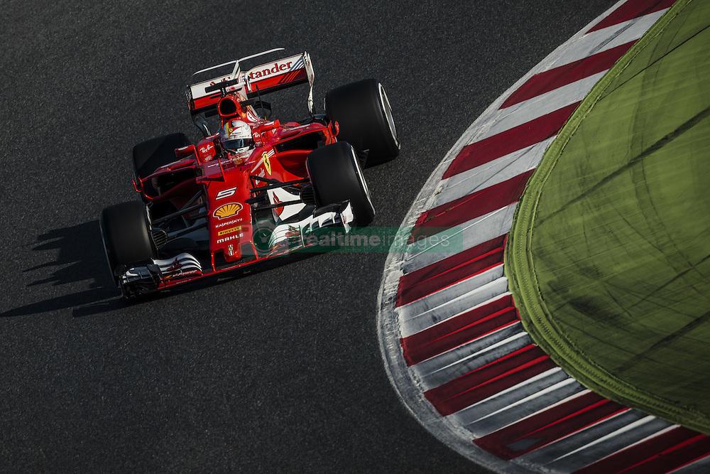 February 27, 2017 - SEBASTIAN VETTEL (GER) drives in his Ferrari SF70H on the track during day 1 of Formula One testing at Circuit de Catalunya, Spain (Credit Image: © Matthias Oesterle via ZUMA Wire)
