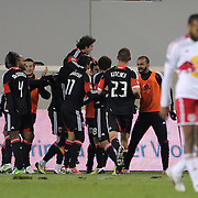 D.C. United players celebrate the winning goal by Nick DeLeon as Thierry Henry walks away during the New York Red Bulls V D.C. United Major League Soccer, Eastern Conference Semi Final 2nd Leg match at Red Bull Arena, Harrison. New Jersey. USA. 8th November 2012. Photo Tim Clayton