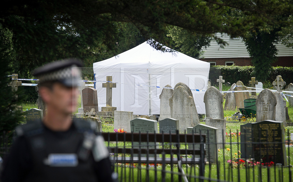 © London News Pictures. 10/07/2012. Writtle, UK. A forensics tent  at the scene where the body of 64 year-old Peter Reeve was  found in the graveyard at All Saints CHurch in Writtle, Essex on July 10, 2012. Peter Reeve was being hunted by police in connection with the murder of Pc Ian Dibell in Clacton.  Photo credit: Ben Cawthra/LNP.