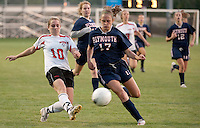 Laconia's Alex Haley takes a shot ahead of Plymouth's Christin B-Reals during the NHIAA Division II varsity soccer game at Robbie Mills Field Friday evening.  (Karen Bobotas/for the Laconia Daily Sun)